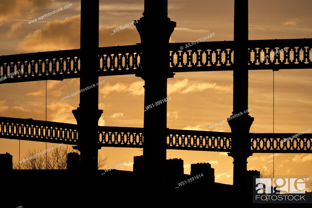 Stock Photo: Gasworks at sunset by Regent's canal, London, UK.