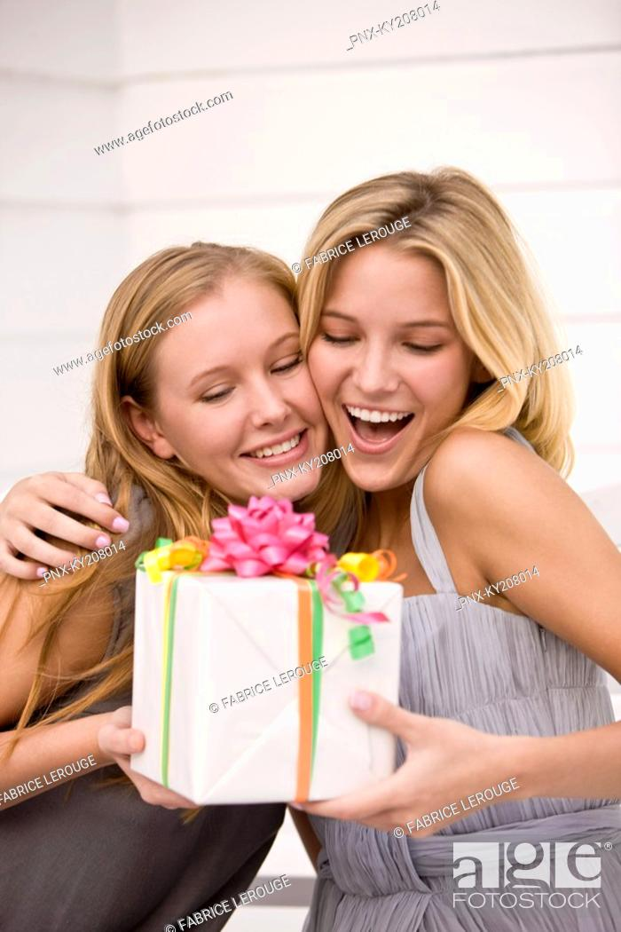 Stock Photo: Woman giving a present to her friend.