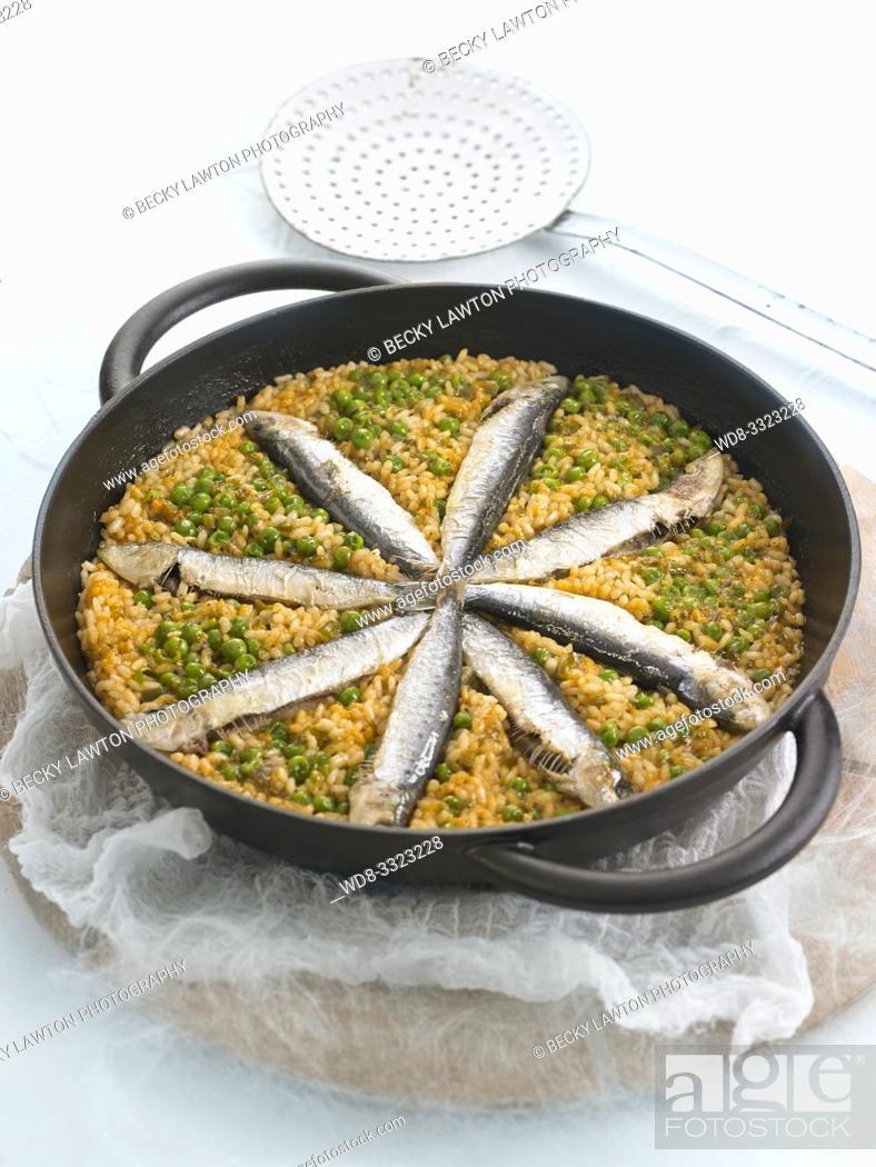 Stock Photo: arroz con sardinas.