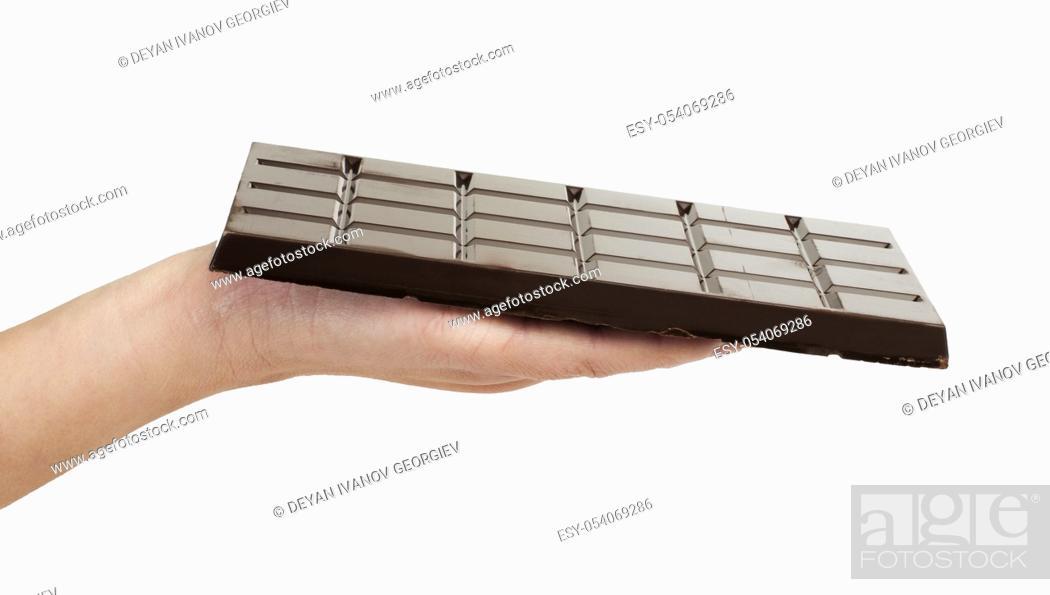 Stock Photo: Hand holding chocolate bar. White isolated.