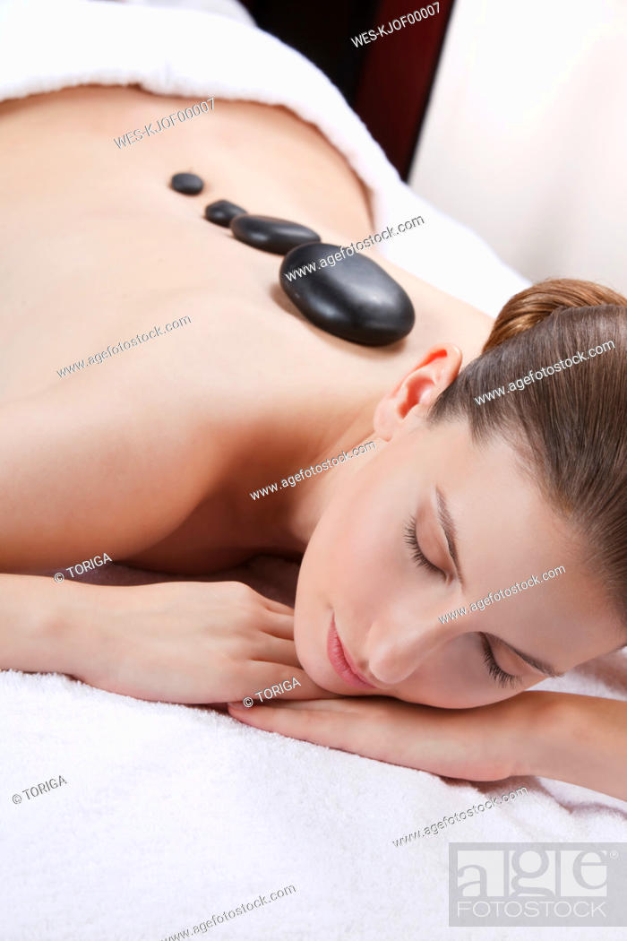Stock Photo: Woman with eyes closed having lastone therapy.