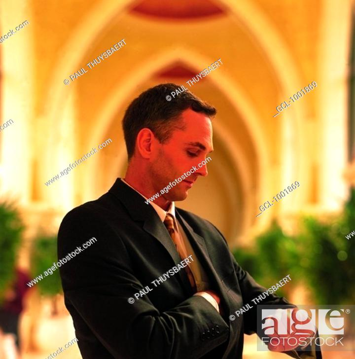 Stock Photo: Businessman checking the time.