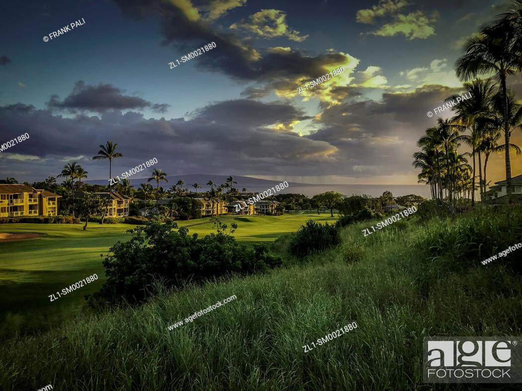 Stock Photo: Grand Champion Resort and the Wailea Blue Golf course with the Maui sunset. Hawaii.