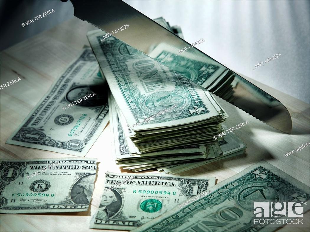 Stock Photo: money cut with knife.