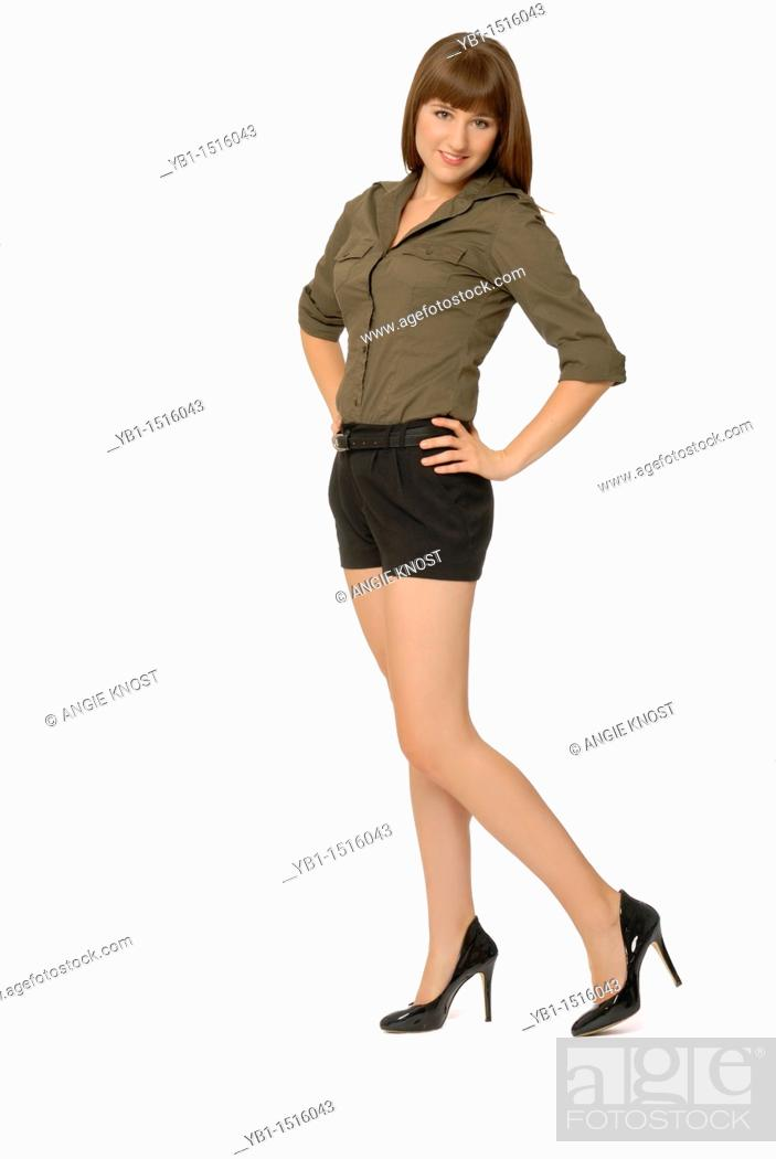Stock Photo: Attractive Woman Wearing Button-down Shirt, Shorts and High Heels.