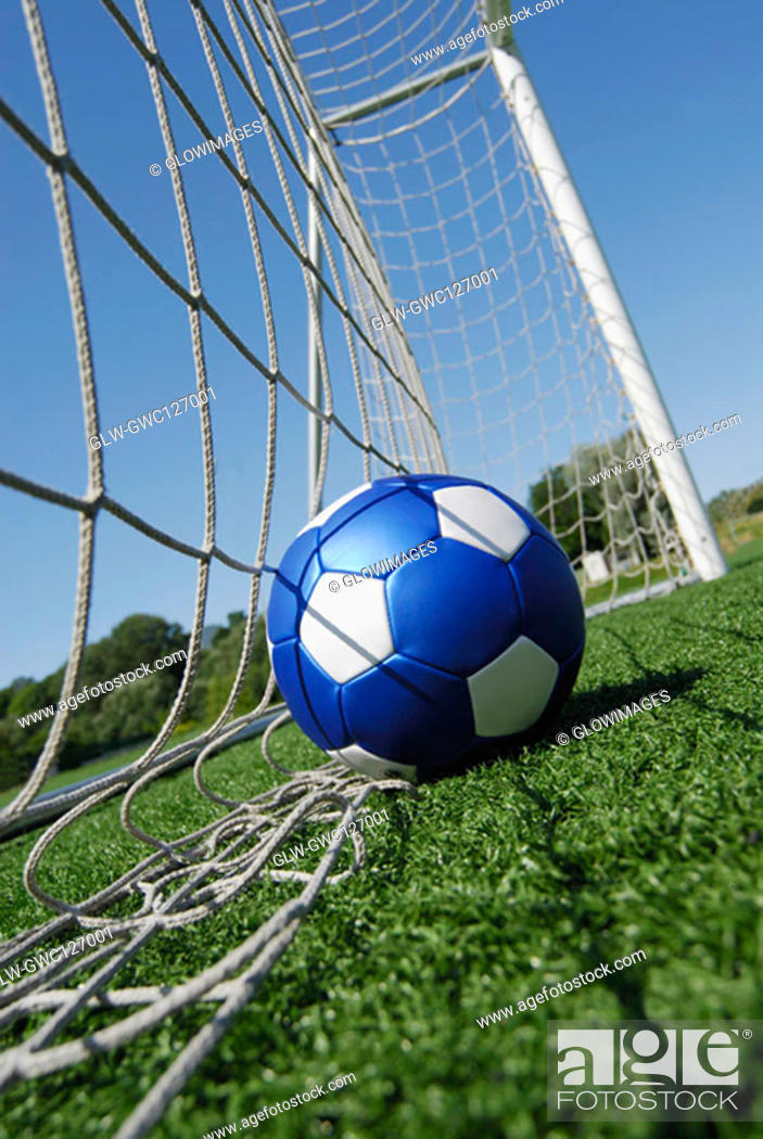 Stock Photo: Close-up of a soccer ball in a net.