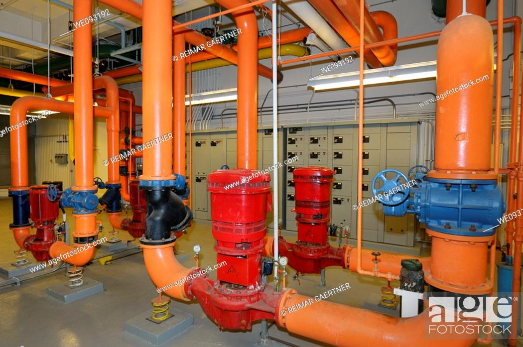 Stock Photo: Electrical heating control and water pipes in the boiler room of a highrise office building.