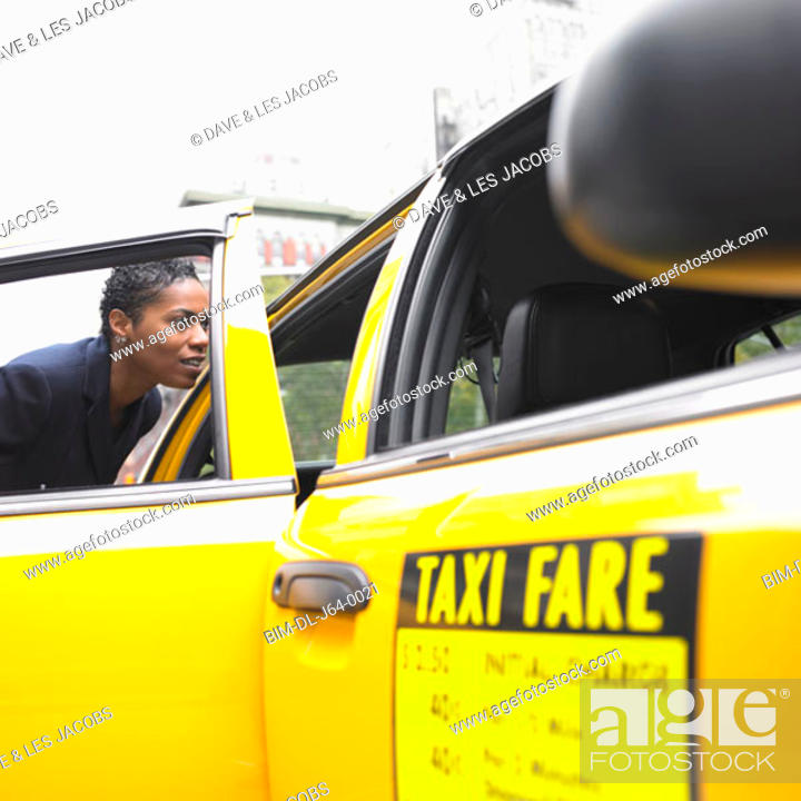 Stock Photo: Businesswoman getting into cab.
