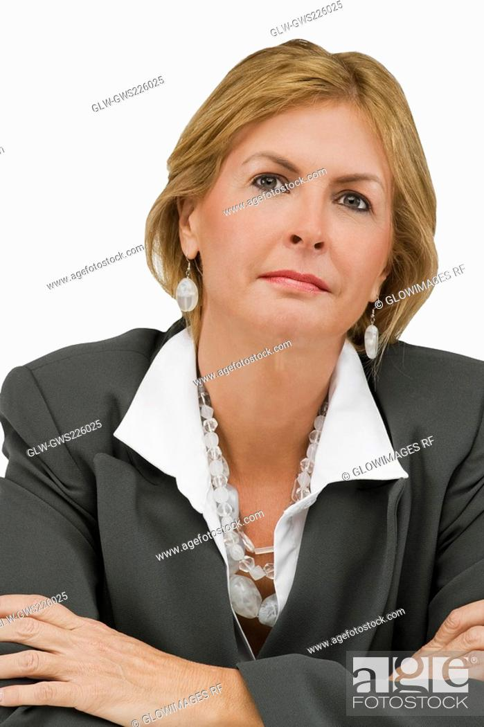 Stock Photo: Close-up of a businesswoman thinking with her arms crossed.