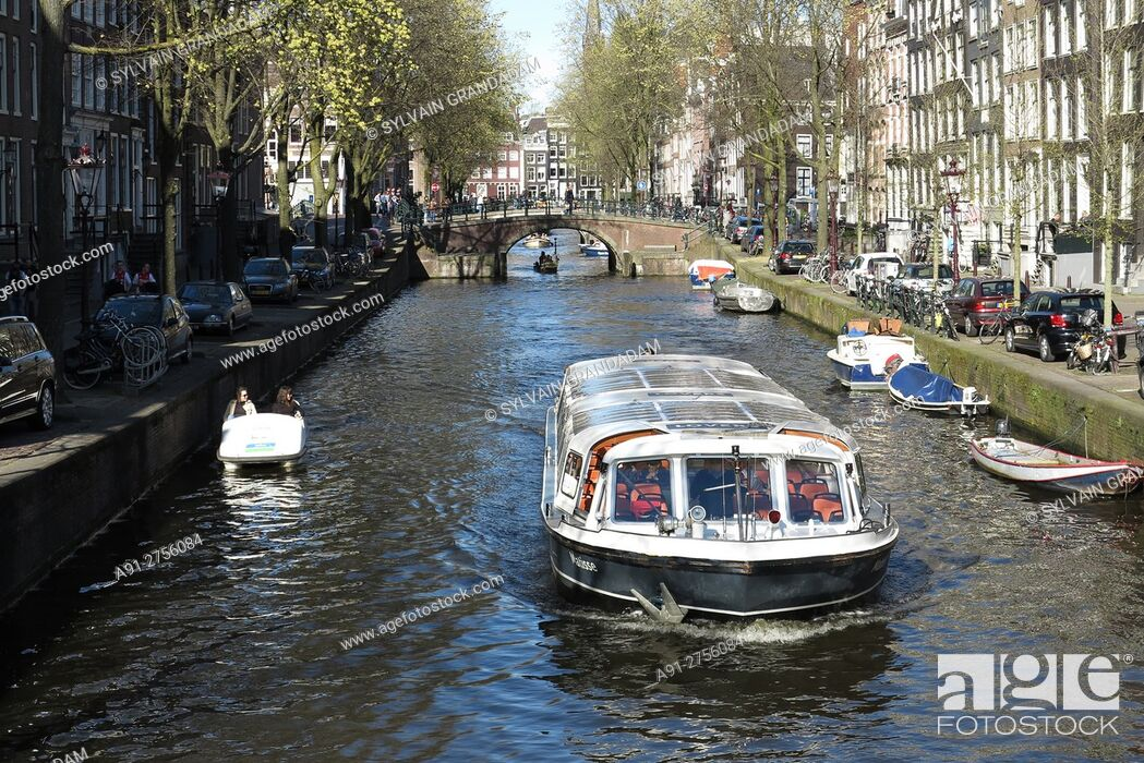Stock Photo: Netherlands, Amsterdam, canal scene.