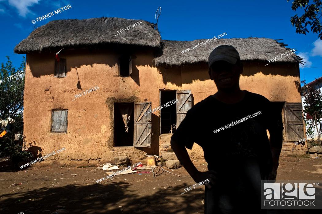 Stock Photo: Portrait of a man belonging to the Betsileo ethnic group. He is standing in front of his house. At Ambositra ( Madagascar).