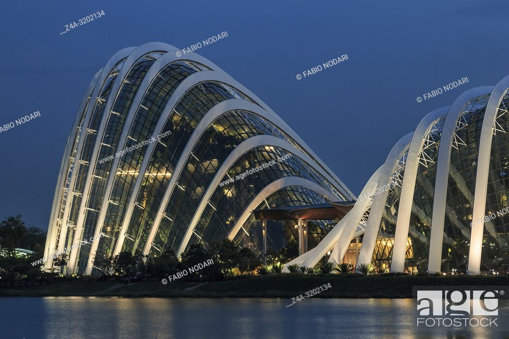 Stock Photo: Cityscape view of the Gardens By the Bay including the Flower Dome, Cloud Forest Dome and Supertree grove at sunset.