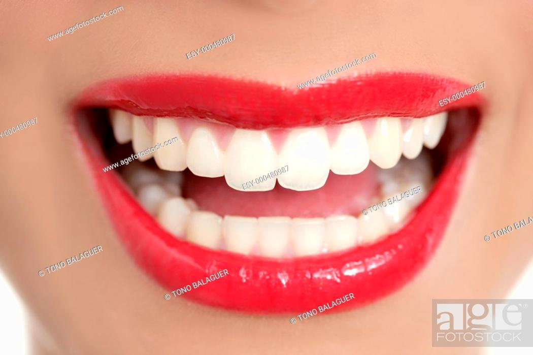 Photo de stock: Beautiful woman perfect teeth smile with red lips.