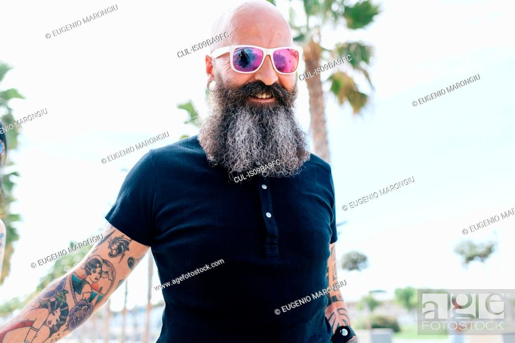Stock Photo - Portrait of mature male hipster in sunglasses