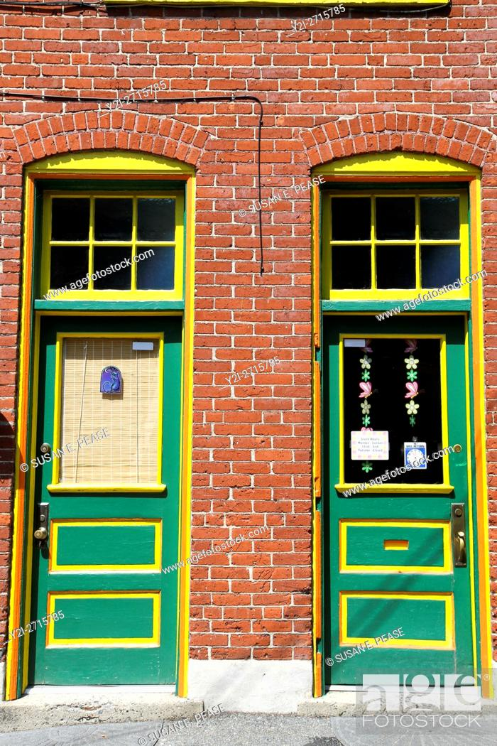 Stock Photo: Colorful doors on a brick building in Jim Thorpe, Pennsylvania, United States, North America.