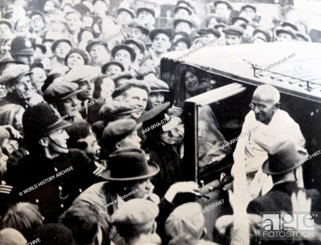 Stock Photo: Mohandas Karamchand Gandhi (1869 – 1948), attends the Round Table Conference in London1931. Gandhi was the preeminent leader of the Indian independence movement.