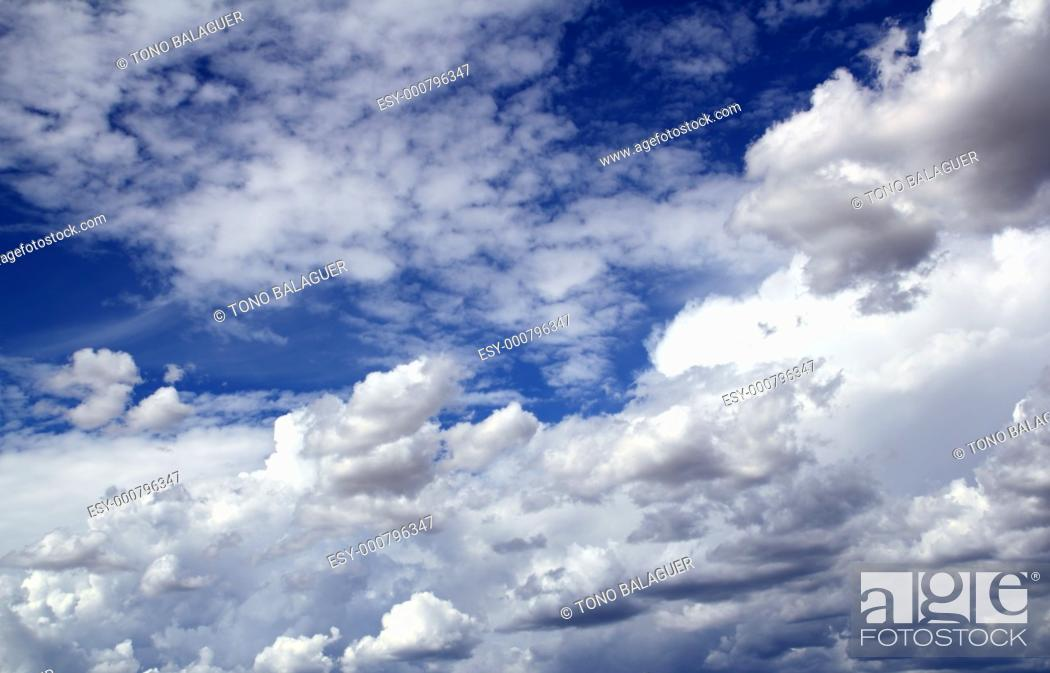 Stock Photo: blue sky skyscape with clouds dramatic shapes background.