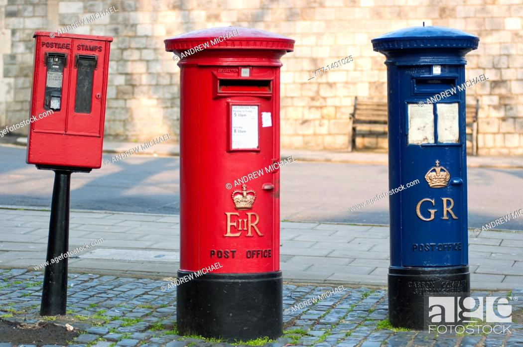 Stock Photo: A blue Royal Mail post box George Regina next to a more common red one Elizabeth Regina in Windsor, Berkshire, UK.