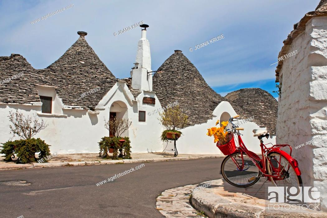 Stock Photo: Alberobello is a city in Apulia, Italy, with Trulli, old stone houses which are typical for this region.