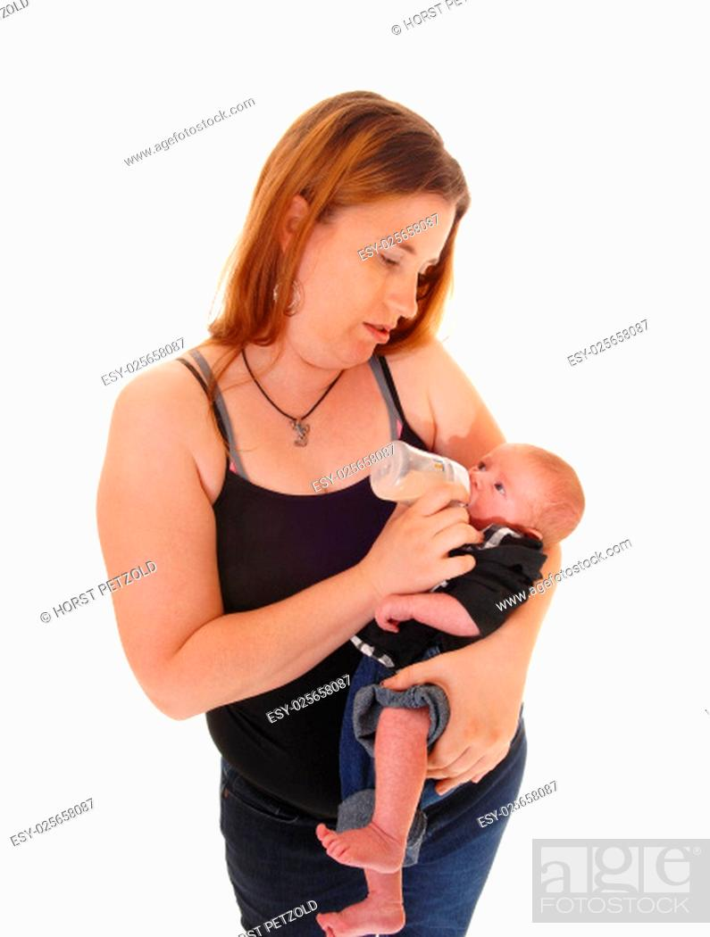 Stock Photo: A young mother feeding her little three weeks old baby boy with a bottle, .closeup, isolated for white background..