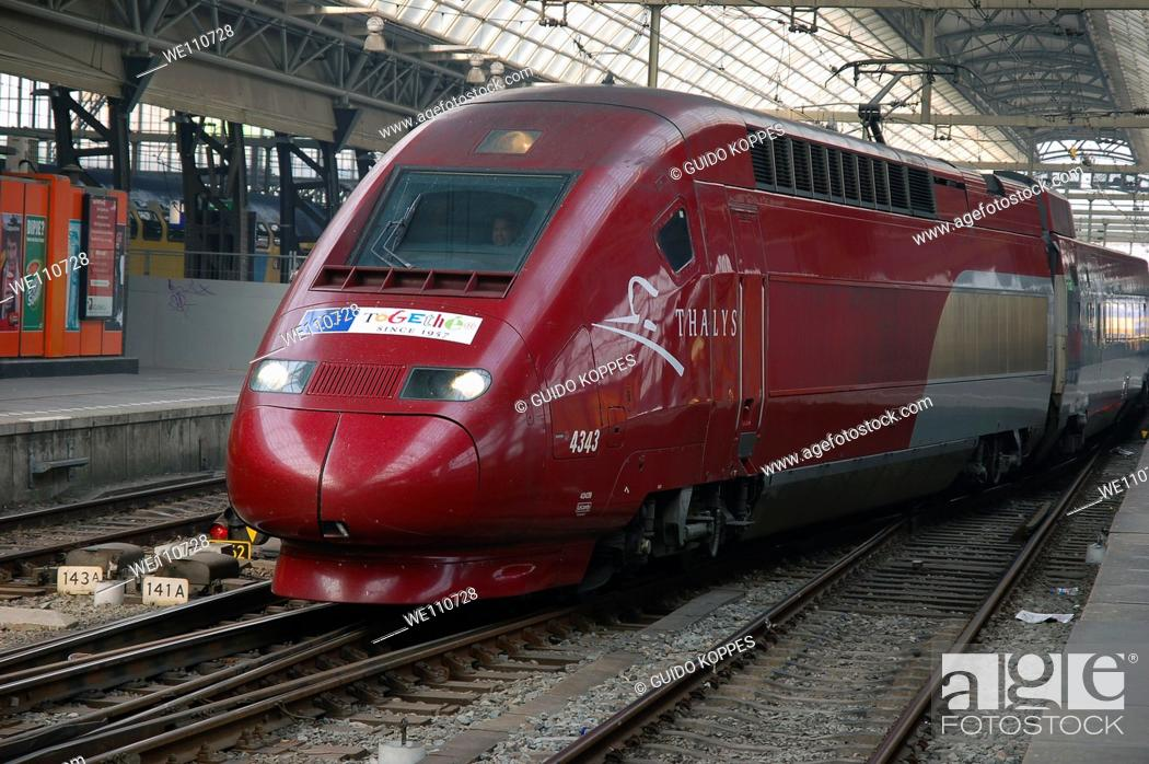 Stock Photo: Amsterdam, Netherlands. High speed Thalys train leaving Amsterdam for a journey to Paris, France.