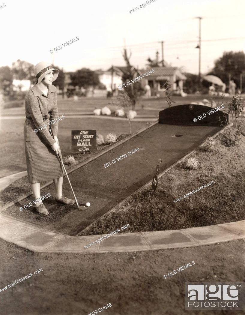 Stock Photo: Enjoying a solo game of miniature golf.