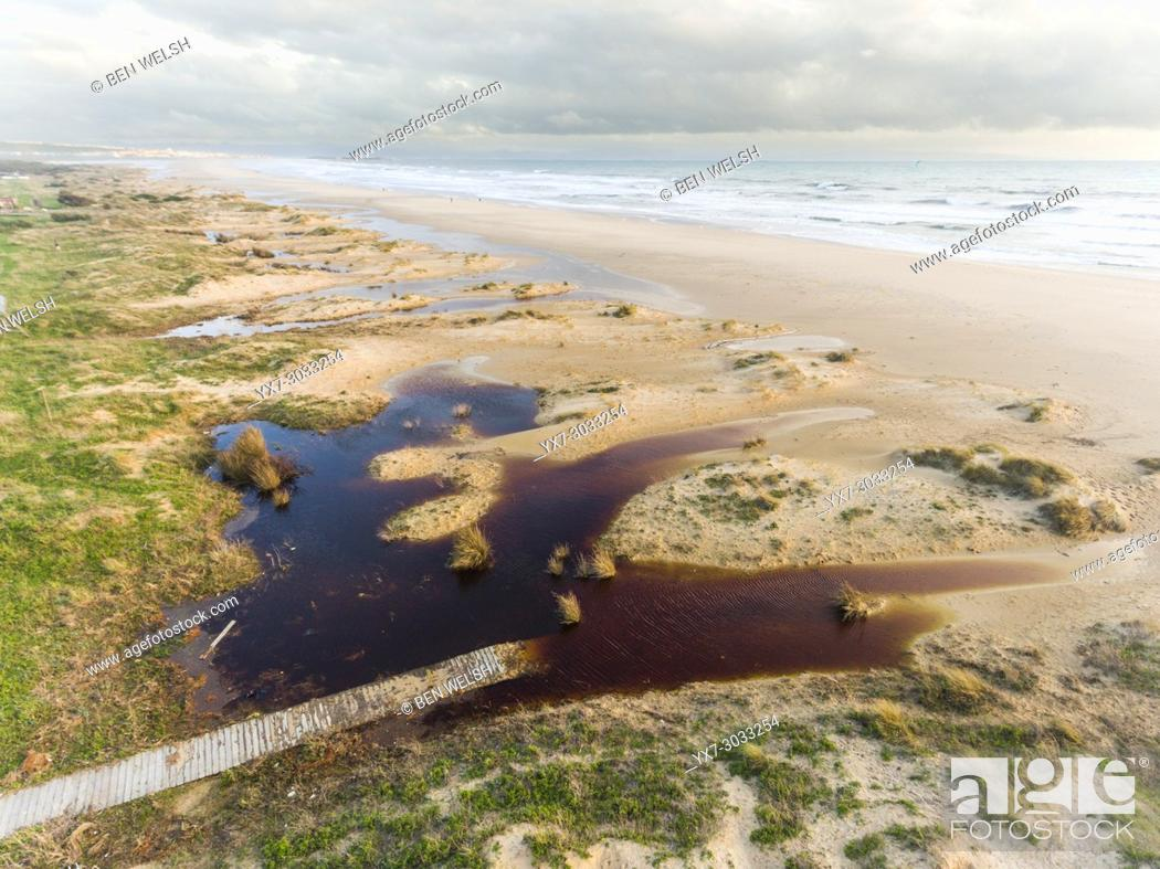 Stock Photo: Los Lances beach inundated after a storm. Tarifa, Costa de la Luz, Cadiz, Andalusia, Spain.