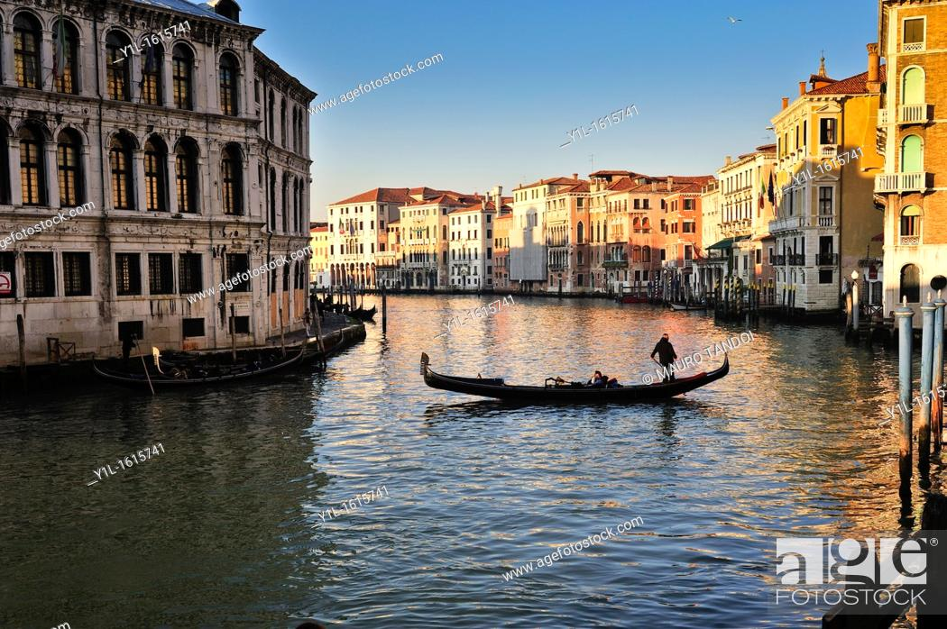 Stock Photo: Grand Canal of Venice at sunset with gondola.