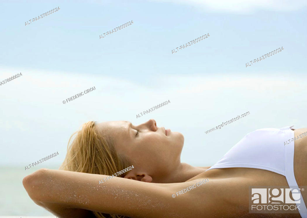Stock Photo: Woman sunbathing, profile.