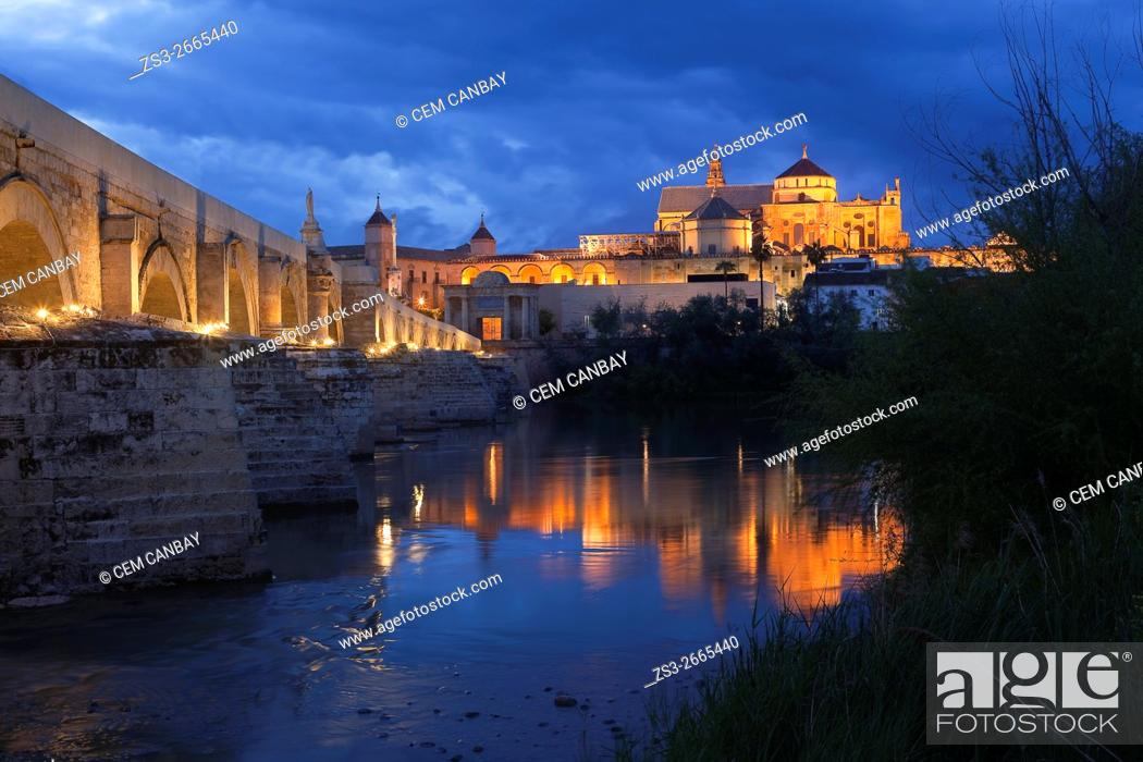 Stock Photo: View to the Guadalquivir river and Roman bridge with the Cathedral and Great Mosque at the background in historic centre of Cordoba, Andalucia, Spain, Europe.