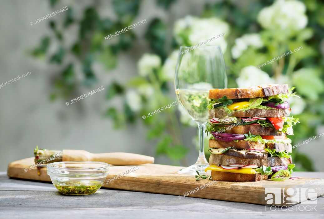 Photo de stock: Large sandwich and white wine.