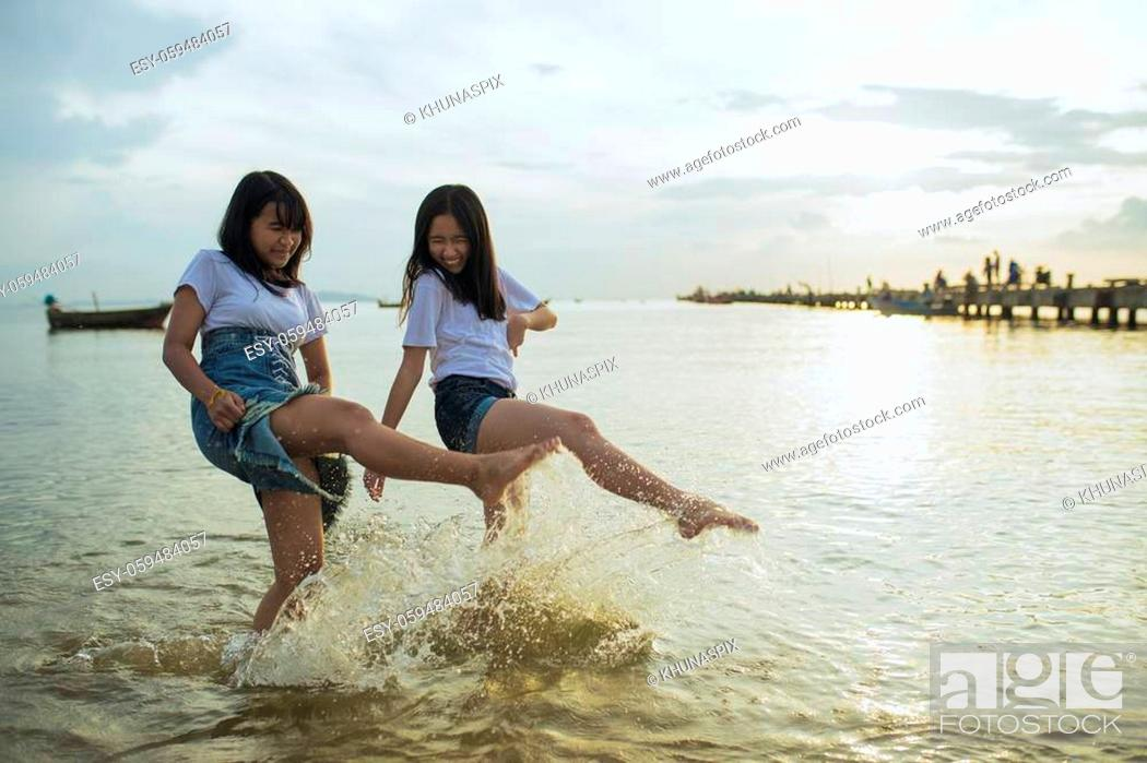 Stock Photo: asian teenager relaxing on vacation sea beach.