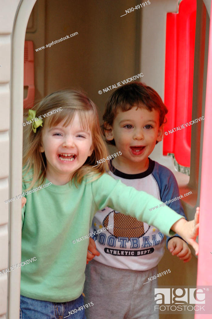 Stock Photo: Toddler girl and boy playing in house.