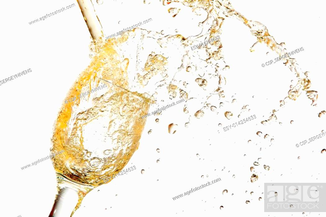 Stock Photo: White wine pouring into glass.