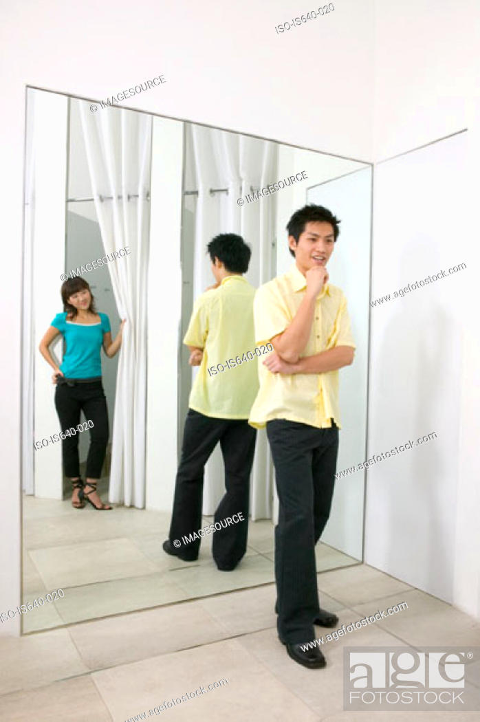 Stock Photo: Young couple in clothes store.