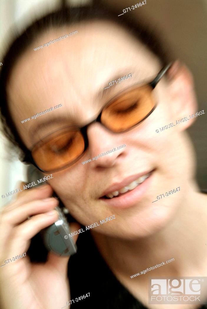 Stock Photo: Woman talking on cell phone.