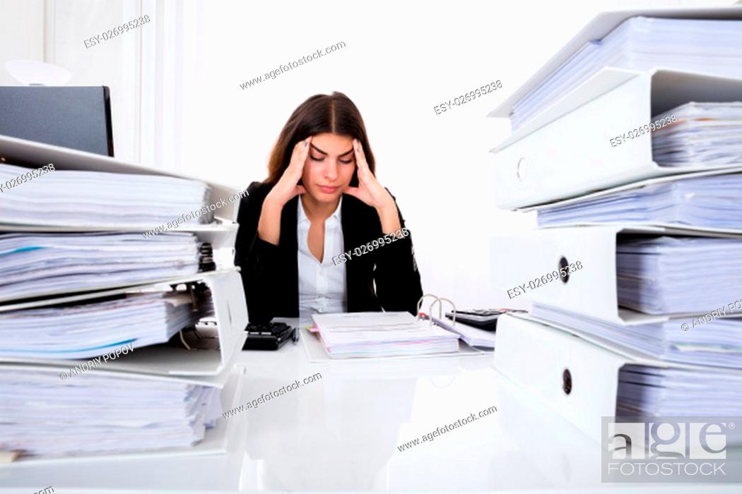 Stock Photo: Young Depressed Businesswoman Checking Invoice In Office.