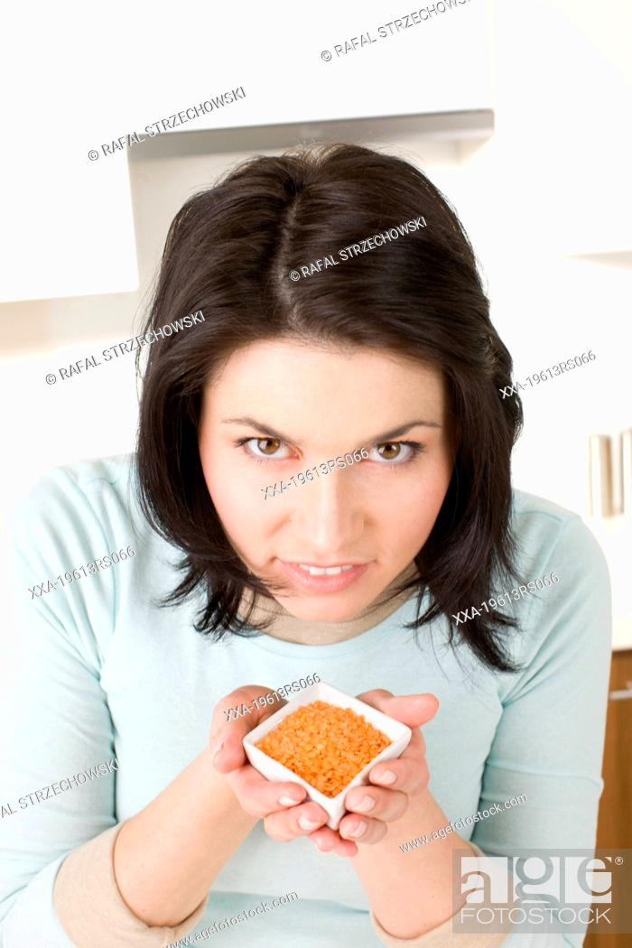 Stock Photo: Woman with red lentil.