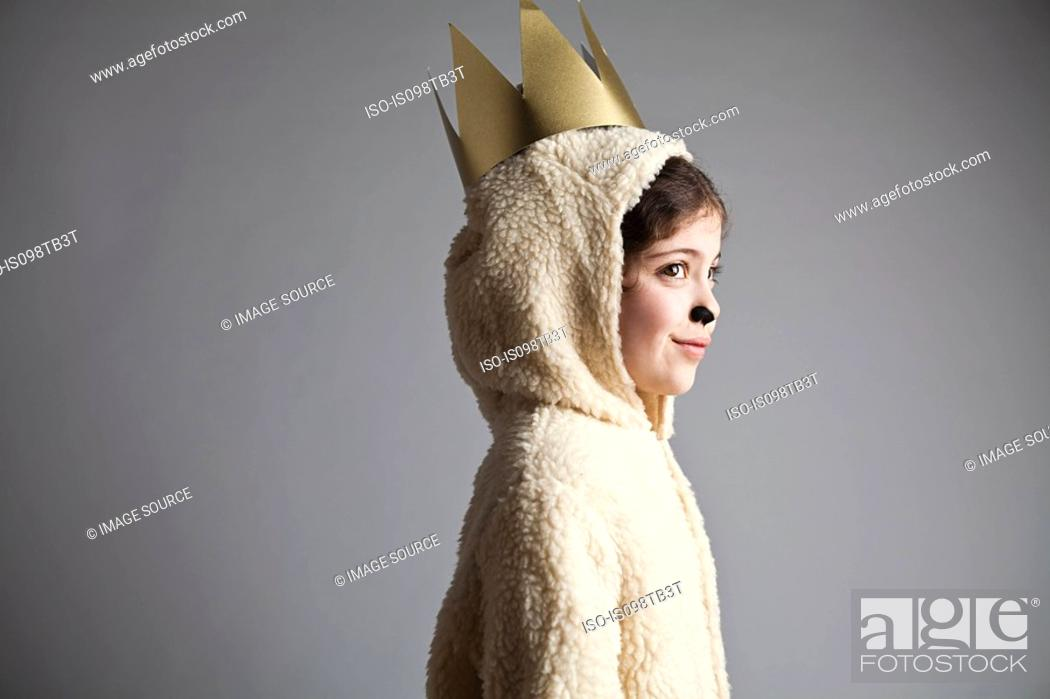 Stock Photo: Young girl dressed up as sheep, wearing gold crown.