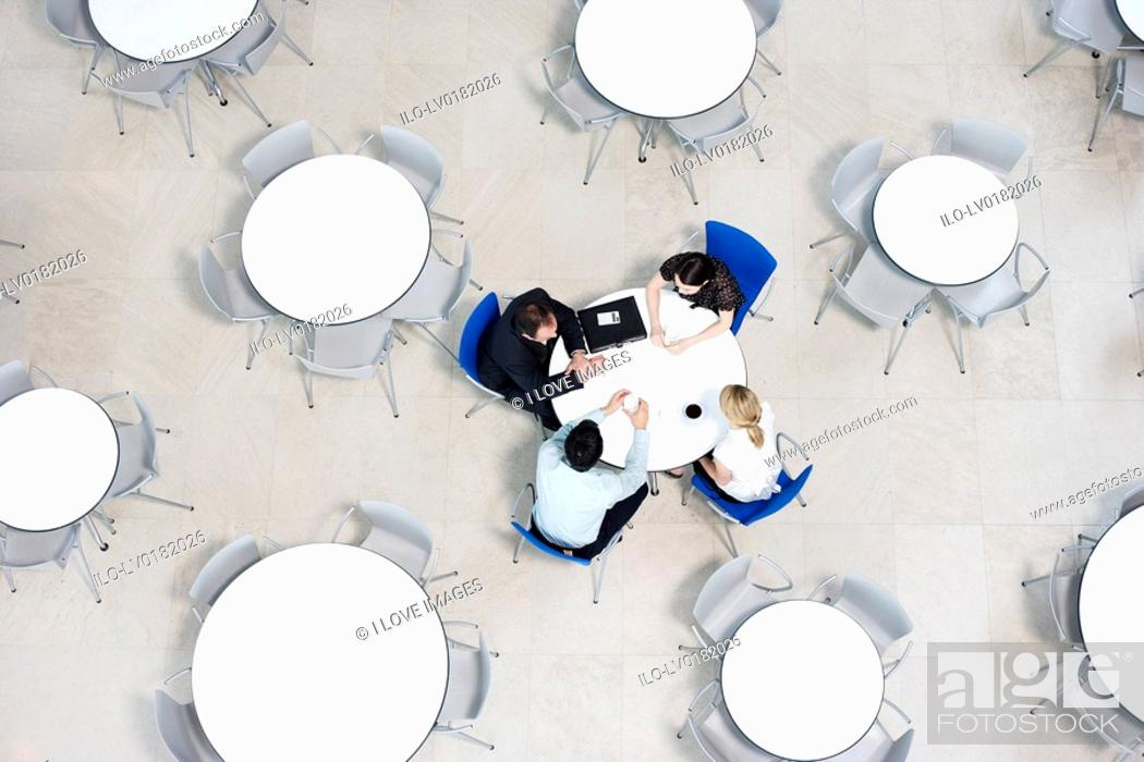 Stock Photo: Overhead view of informal business meeting at table of staff canteen.