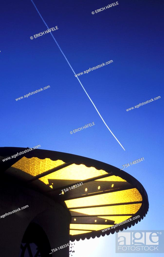 Stock Photo: Contrail of an aircraft above the low sun of southern Italy.