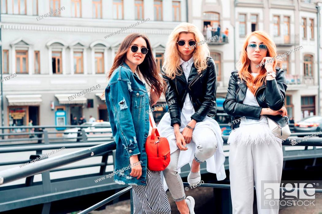 Stock Photo: Three women are posing on the street city.
