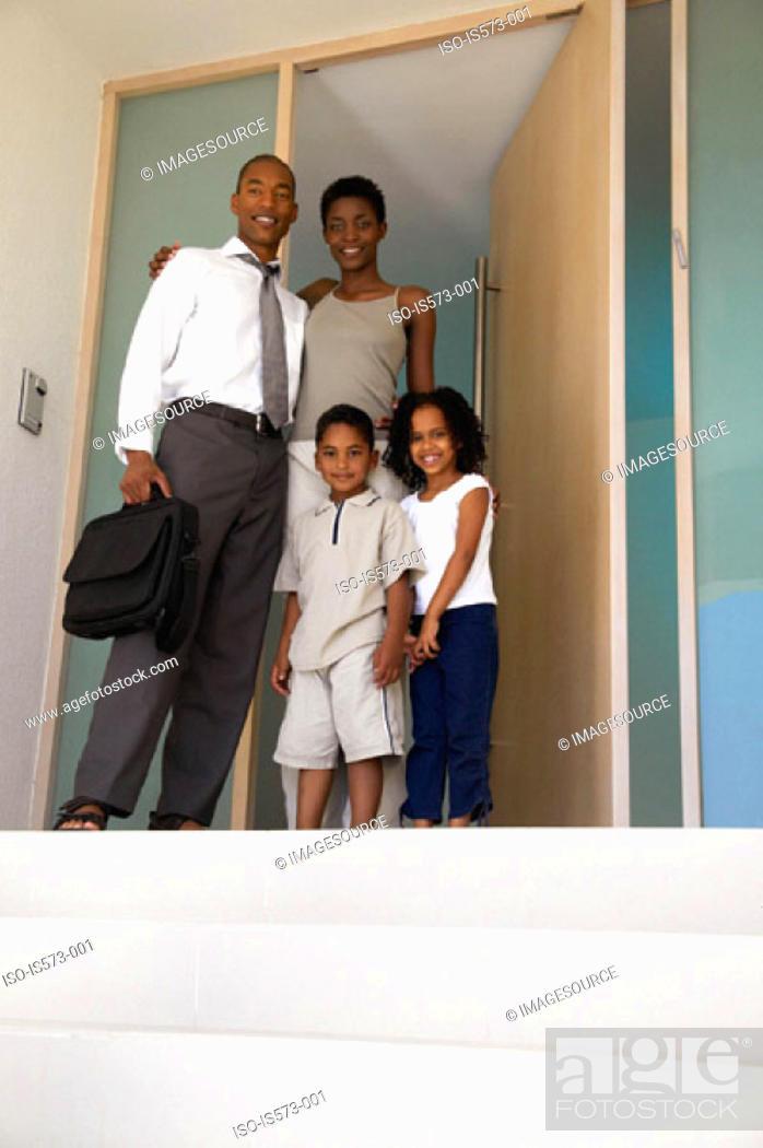 Stock Photo: Family standing in doorway.