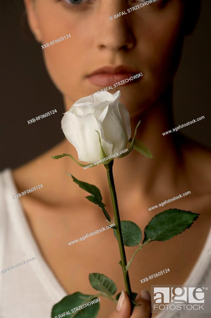 Stock Photo: woman with white rose.