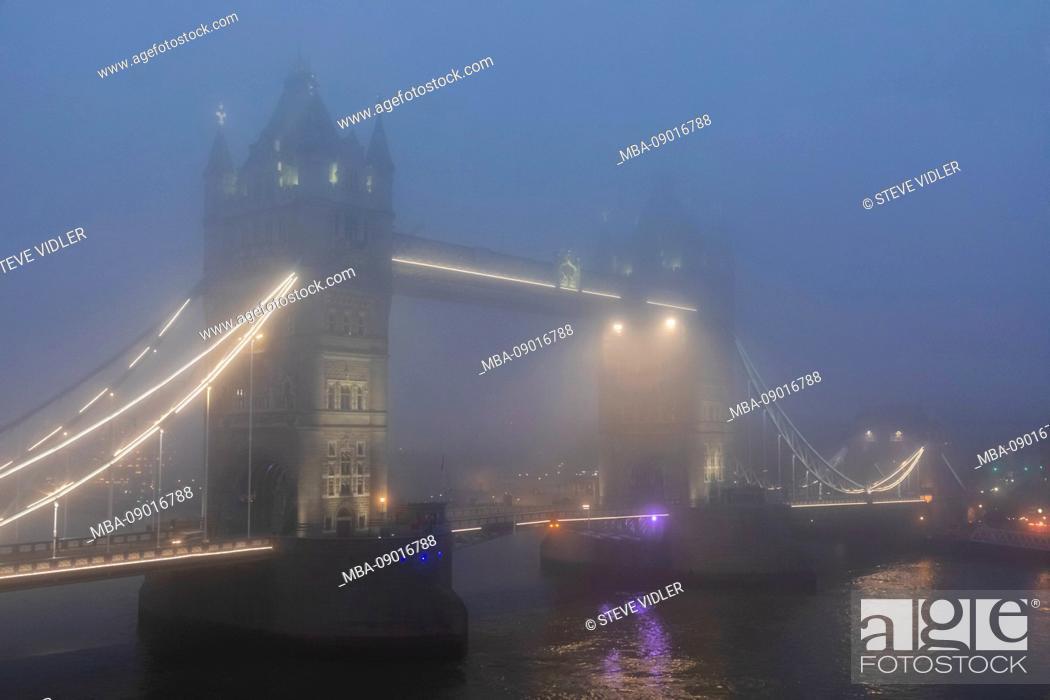 Stock Photo: England, London, Tower Bridge in the Fog at Night.