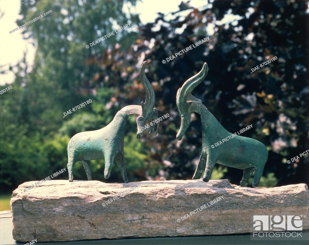 Stock Photo: Prehistory, Norway, Bronze Age - Two-horned bronze animal figures from Vestby.  Oslo, Kulturhistorisk Museum Universitetet I Oslo.