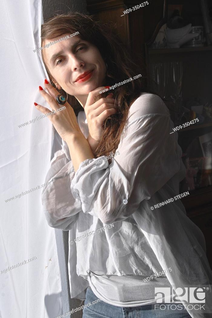 Stock Photo: attractive young woman, daydreaming in casual dress.