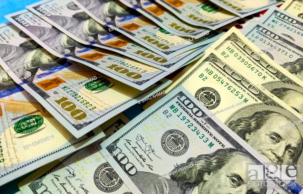 Stock Photo: Close up of new and old american hundred dollar bills bank notes background.