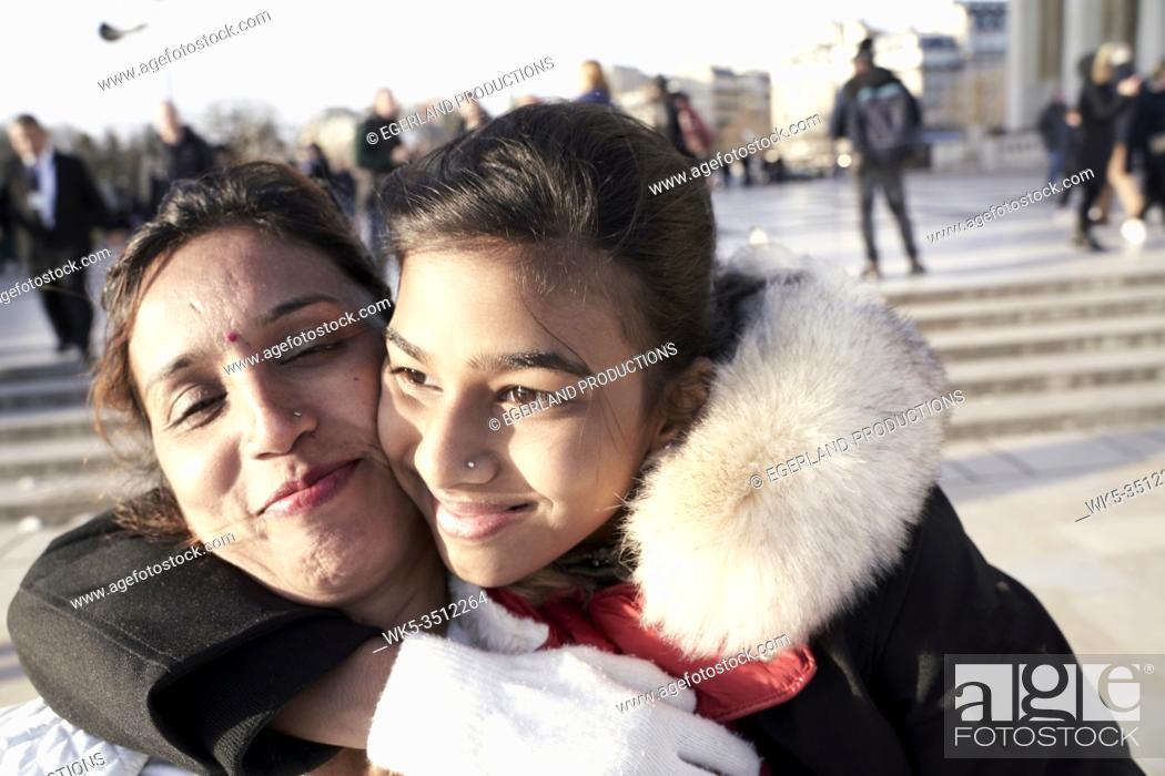 Stock Photo: mother and daughter enjoying embrace. Paris, France.
