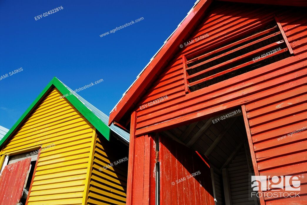 Stock Photo: Multicoloured beach huts on Muizenberg beach, South Western Cape, South Africa.
